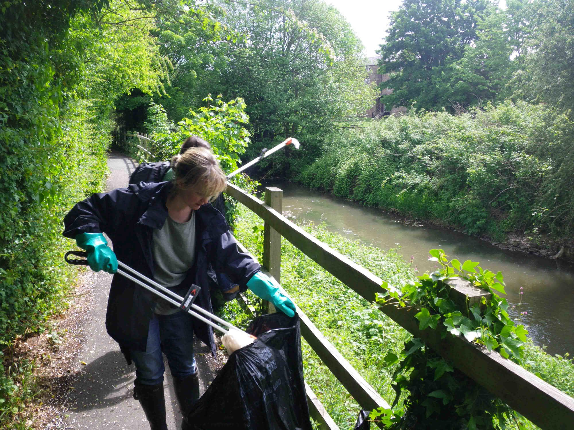 Clearing litter from the banks of the river Lugg