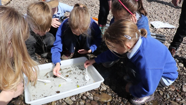 Pupils from Llanfoist Fawr Primary School at the Freshwater Friends appeal launch, discovering what lives in the river Usk and why clean water is so important to them.